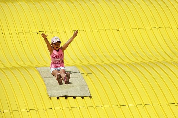 Girl Enjoying Trip Down Giant Slide