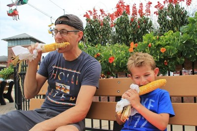 Father & Son Enjoying Corn on the Cob
