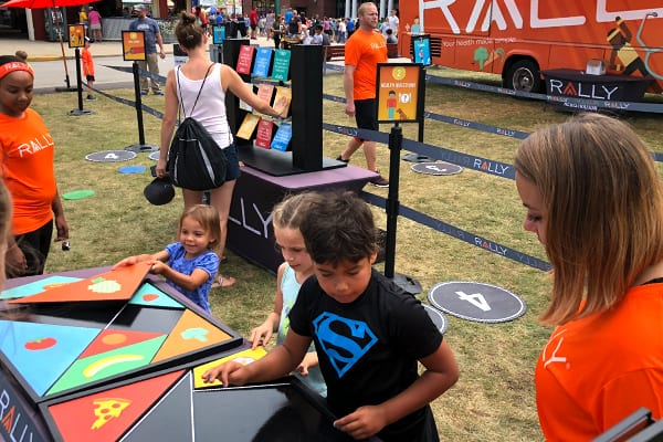 Fairgoers Interacting with Brand Experience Exhibit